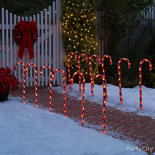 Candy cane walkway idea party city for Sidewalk christmas lights