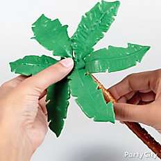 Attach leaves to pretzel rod tree