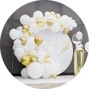 White and gold latex balloon arch.